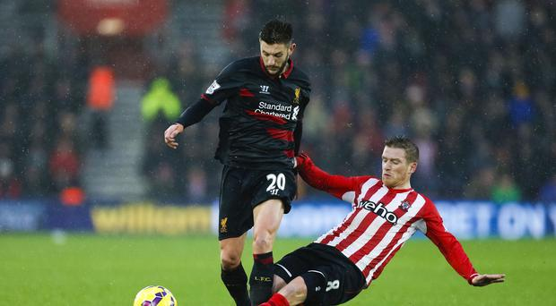 Liverpool's Adam Lallana, left, came in for praise from Brendan Rodgers on his return to Southampton
