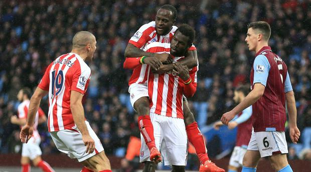 Stoke's Mame Biram Diouf, centre bottom, celebrates his equaliser at Aston Villa with Victor Moses and Jonathan Walters, left, in their 2-1 win on Saturday