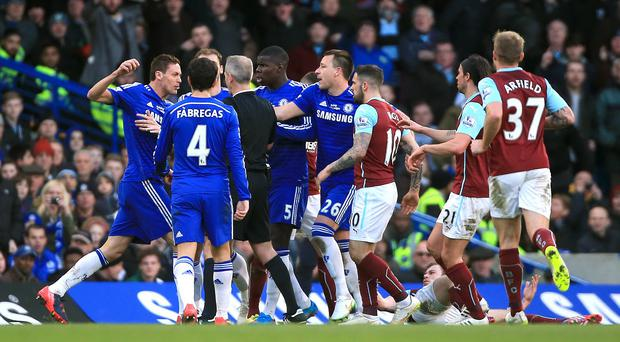 Nemanja Matic, left, reacts following the challenge from Ashley Barnes, pictured on the ground