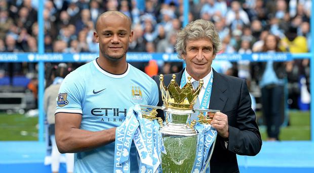 Manuel Pellegrini, right, expects captain Vincent Kompany, left, to prove critics wrong