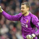 Liverpool goalkeeper Simon Mignolet has hailed the team's improved defensive resilience