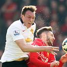 Phil Jones, left, and Chris Smalling performed well against a potent Liverpool attack at Anfield