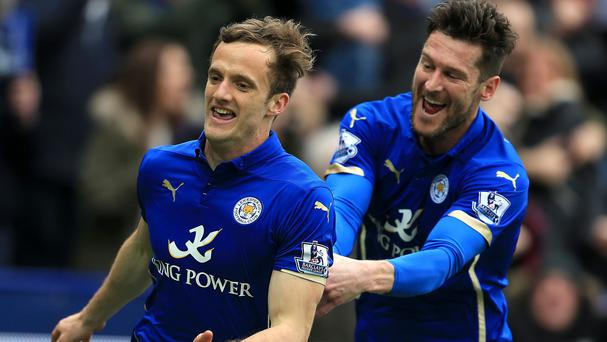 Andy King, left, celebrates scoring the winner