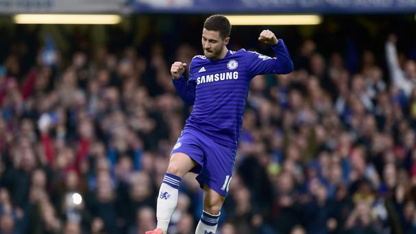 Eden Hazard celebrates after converting his penalty