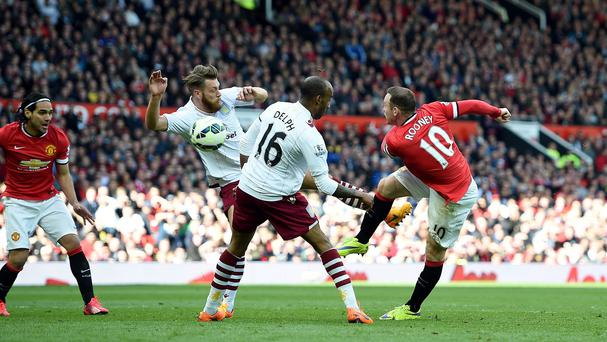 Wayne Rooney, right, scores Manchester United's second goal against Aston Villa