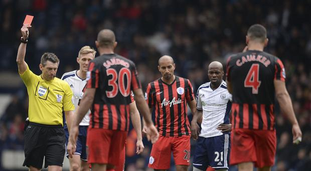 Referee Lee Probert sends off Youssouf Mulumbu, second from right, after his challenge on QPR's Joey Barton during the Hoops' 4-1 win