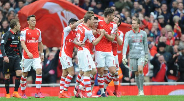 Hector Bellerin, centre, celebrates with team-mates after scoring his side's first goal of the game