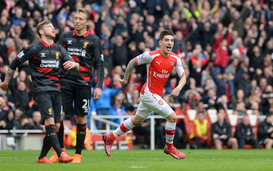 Hector Bellerin wheels away in celebration after opening the scoring against Liverpool