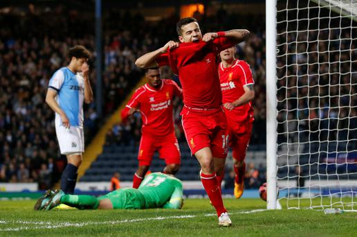 Philippe Coutinho celebrates after scoring what turned out to be the winning goal against Blackburn in the FA Cup quarter-final replay