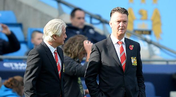 Louis Van Gaal, right, tasted defeat in his first Manchester derby thanks to Sergio Aguero's goal