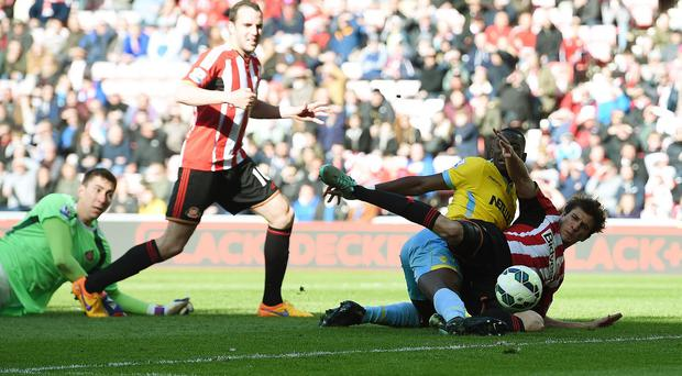 Yannick Bolasie, second right, bundles home Crystal Palace's third goal