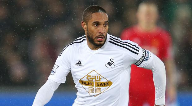 Ashley Williams, pictured, has praised Garry Monk's recruitment policy and tactical ability