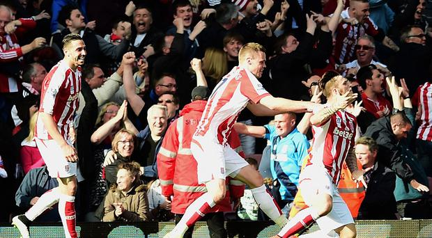 Stoke's Marko Arnautovic, right, scored a dramatic equaliser deep into stoppage time at West Ham