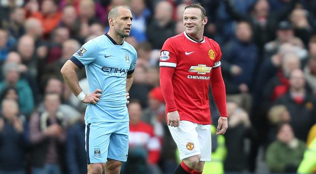Pablo Zabaleta, left, concedes Manchester City face a fight to retain their Champions League place