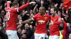 Ashley Young, centre, and Juan Mata, right, were on target at Old Trafford