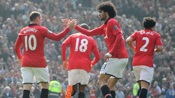 Wayne Rooney, left, believes Marouane Fellaini is a quality player