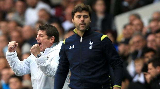 Mauricio Pochettino, right, says he knows how under-pressure Newcastle boss John Carver feels