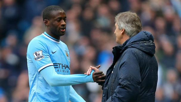 Manchester City's Yaya Toure, left, has not been at his best this season, manager Manuel Pellegrini, right, admits