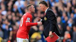 Wayne Rooney, left, and Louis van Gaal, right.