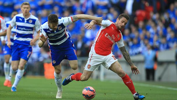 Mathieu Debuchy, right, battles for possession with Reading's Jamie Mackie in the FA Cup semi-final