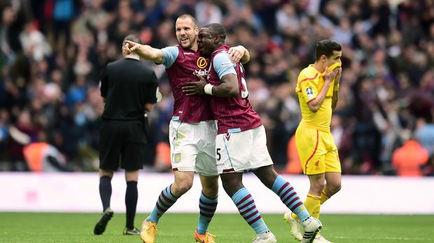 Ron Vlaar, left, celebrates with Jores Okore at the end of Sunday's FA Cup semi-final