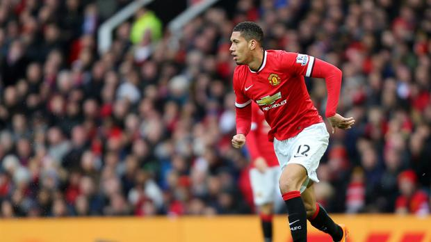 Defender Chris Smalling has signed a new contract at Manchester United