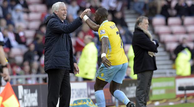 Alan Pardew, pictured left, is fighting to hold onto coveted winger Yannick Bolasie, right