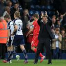 Liverpool manager Brendan Rodgers (centre right) applauds supporters after the final whistle during the Barclays Premier League match at The Hawthorns, West Bromwich.