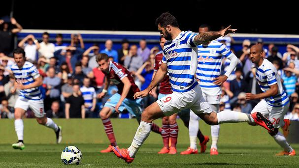 QPR's Charlie Austin misses a penalty kick against West Ham