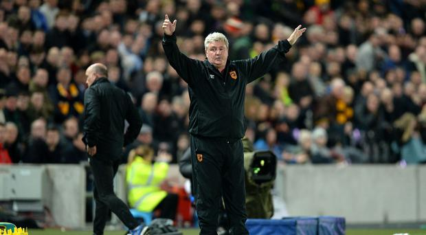 Hull City manager Steve Bruce wants his side to remain grounded after their win over Liverpool