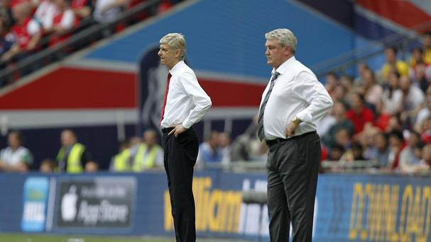Arsenal's manager Arsene Wenger, pictured left, and Hull's manager Steve Bruce on the touchline at last year's FA Cup final