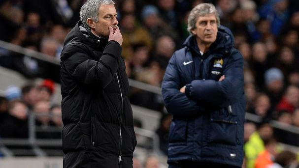Manuel Pellegrini, right, believes Jose Mourinho, left, sets his team out like a small team