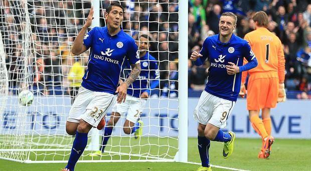 Leonardo Ulloa, left, scored twice in Leicester's win
