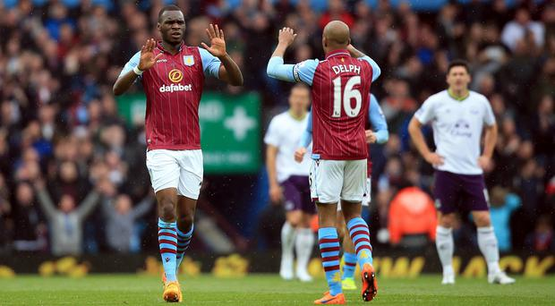 Christian Benteke celebrates scoring the opener with Fabian Delph as Aston Villa earned a crucial win