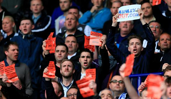 Newcastle fans show their displeasure during the defeat at Leicester