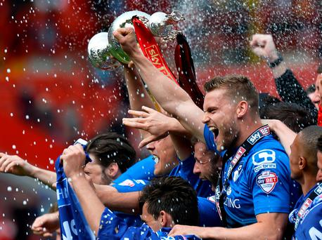Bournemouth players celebrate with the Championship trophy