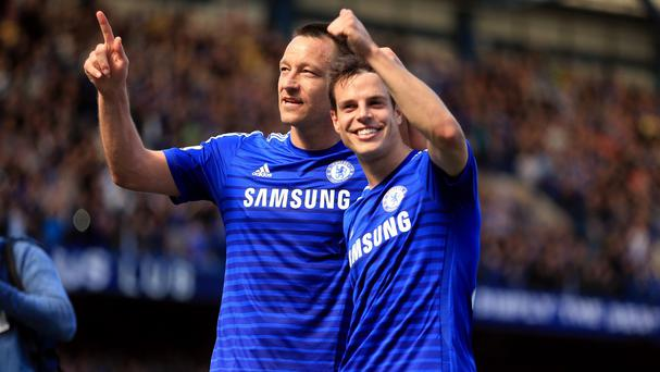 John Terry, left, will lift the Premier League trophy for a fourth time on May 24