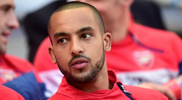 Theo Walcott, pictured, will not be leaving Arsenal this summer according to manager Arsene Wenger