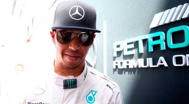 Lewis Hamilton walks into the garage during practice for the Spanish Formula One Grand Prix at Circuit de Catalunya