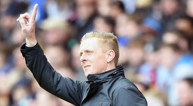 Swansea's Garry Monk, pictured, says Arsene Wenger's praise is a 'massive compliment'