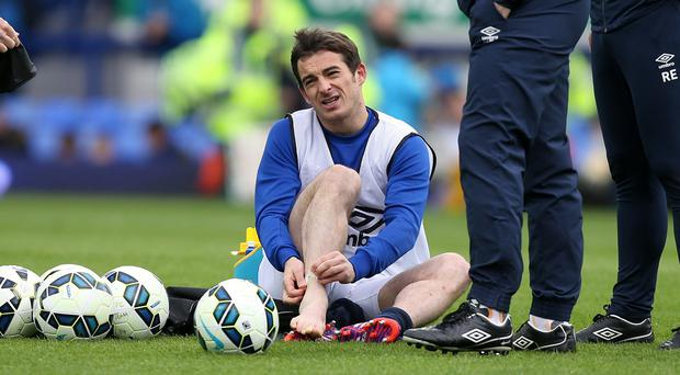 Everton left-back Leighton Baines will see a specialist about his ankle injury