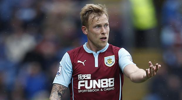 Burnley midfielder Scott Arfield, pictured, is hopeful Sean Dyche's men can start once again with the team spirit they have forged largely intact