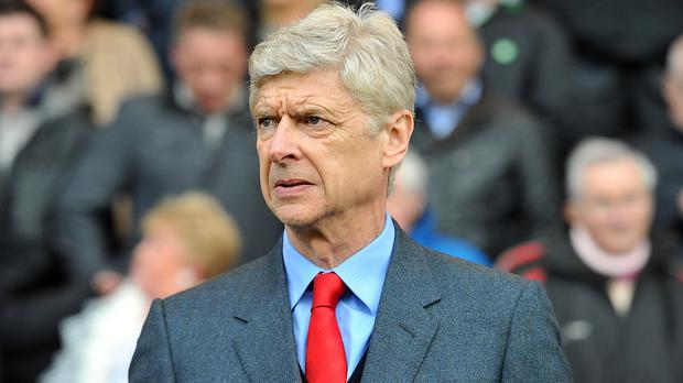 Arsene Wenger's Arsenal side face Manchester United at Old Trafford on Sunday