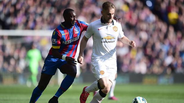 Luke Shaw, right, has had a difficult first season at Manchester United