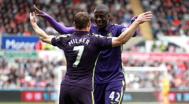 Yaya Toure netted twice for Manchester City yesterday