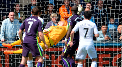 Joe Hart flies across his goal to make a wonder save from Federico Fernandez. GETTY