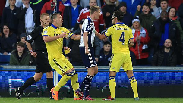 Darren Fletcher, centre, and Cesc Fabregas squared up before the Chelsea man was dismissed