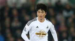 Swansea's Ki Sung-yueng has undergone knee surgery to be fit in time for next season