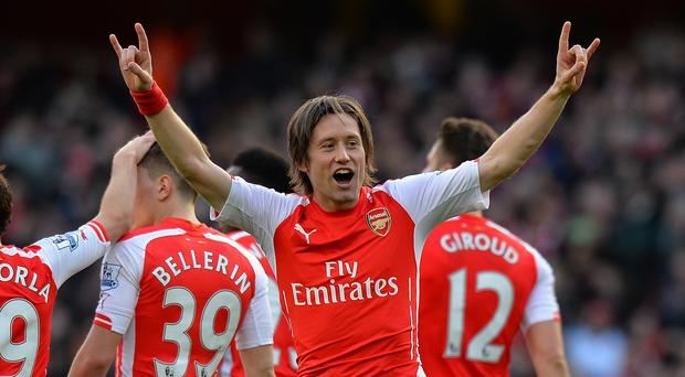 Midfielder Tomas Rosicky is set to stay at Arsenal next season