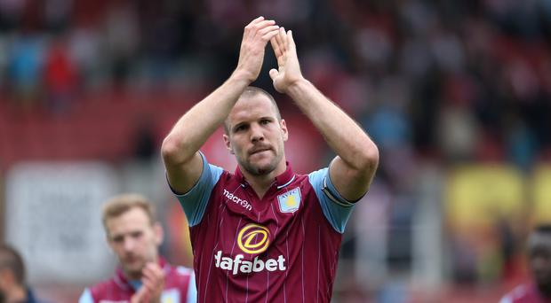 Tim Sherwood is confident Ron Vlaar, pictured, will stay at Aston Villa